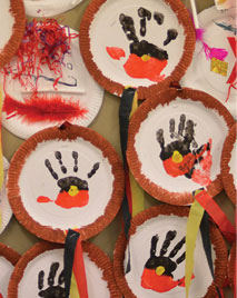 Hand paintings depicting the Aboriginal flag