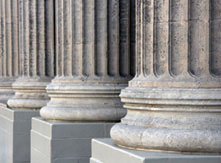 The base of large ornate pillars from a Government building